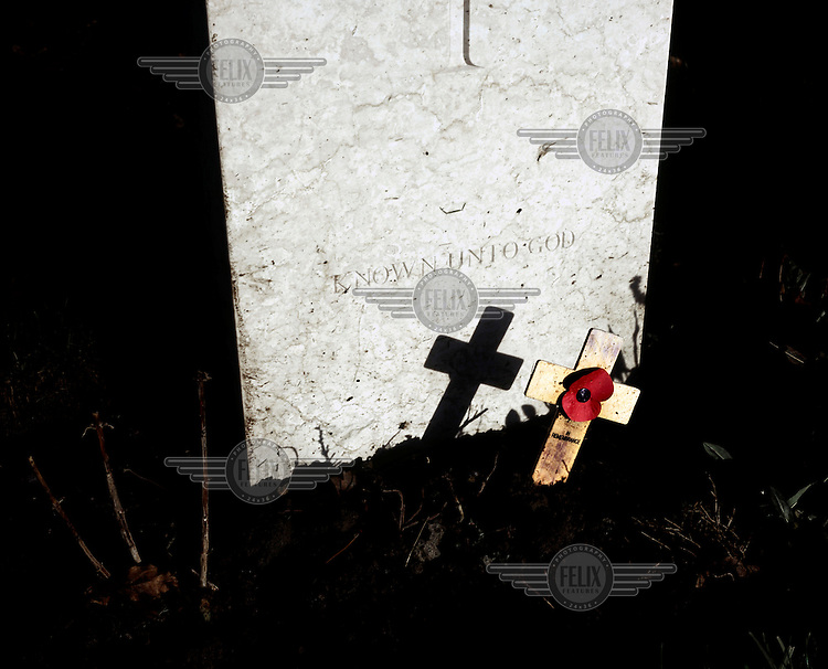 A remembrance poppy on the grave of a soldier in Tyne Cot, the biggest Commonwealth War Cemetery in the world where almost 12,000 men, killed in the Ypres Salient during World War I, are laid to rest.