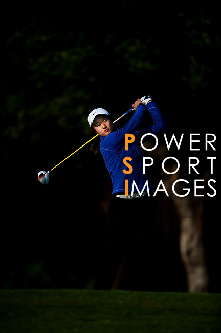 Yu Liu of China plays a shot during the Hyundai China Ladies Open 2014 on December 13 2014 at Mission Hills Shenzhen, in Shenzhen, China. Photo by Xaume Olleros / Power Sport Images