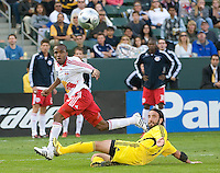 Dane Richards eyes the ball over Gino Padula during MLS Cup 2008. Columbus Crew defeated the New York Red Bulls, 3-1, Sunday, November 23, 2008. Photo by John Todd/isiphotos.com