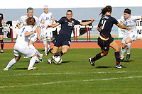 Abby Wambach passes to Lauren Cheney amidst a crop of Iceland defenders.  The USWNT defeated Iceland (2-0) at Vila Real Sto. Antonio in their opener of the 2010 Algarve Cup on February 24, 2010.