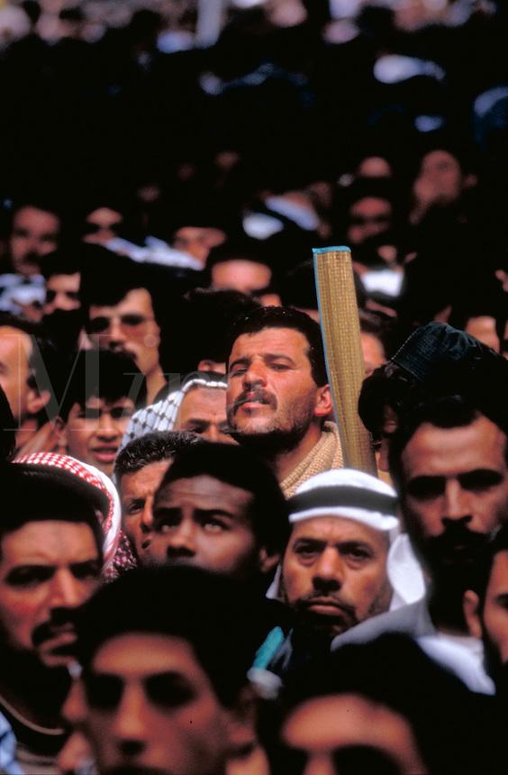 TITLE - DISTANT RELATIONS, ARAB WITH MOSLEM PRAYER RUG LEAVING MOSQUE, ARAB MEN,. JERUSALEM ISRAEL.