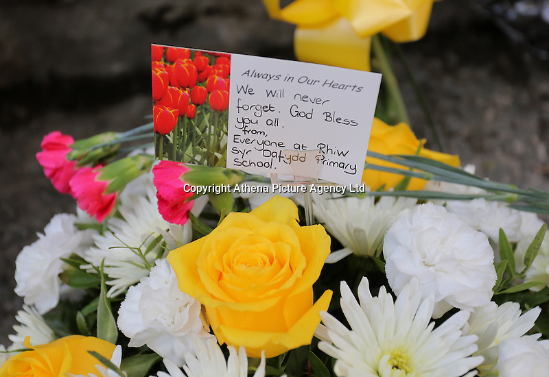 Pictured: Flowers and tributes left at the entrance to the Memorial Garden Friday 21 October 2016<br /> Re: Wales has fallen silent as the country remembered the Aberfan disaster 50 years ago.<br /> On 21 October 1966, a mountain of coal waste slid down into a school and houses in the Welsh village, killing 144 people, including 116 children.<br /> A day of events to commemorate the disaster included a service at Aberfan Cemetery at 9:15am on Friday.<br /> Prince Charles is visiting Aberfan memorial garden before unveiling a plaque in memory of the victims.<br /> He will also attend a reception with the families of some of those who lost their lives, before signing a book of remembrance.