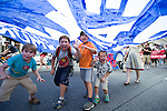 Kids under the umbrella. On July 5th more than 10,000 people gathered in Toronto, the traditional territories of the Missisauga peoples, for the March for Jobs, Justice and the Climate. The march told the story of a new economy that works for people and the planet. People marched for an economy that starts with justice, creates good work, clean jobs and healthy communities. The people recognize that we have solutions and we know who is responsible for causing the climate crisis. (Photo: Robert van Waarden)