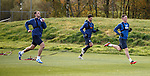 Ross Perry pulling a sled behind him in training alongside Lee Wallace and Emilson Cribari