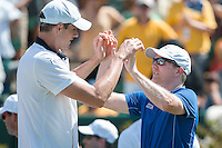 March 6, 2016: John Isner and Jim Courier of USA celebrate winning the first reverse single match against Bernard Tomic of Australia at the BNP Paribas Davis Cup World Group first round tie between Australia and USA at Kooyong tennis club in Melbourne, Australia. USA won in 4 sets. Photo Sydney Low