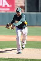 Brian Fuentes #52 of the Oakland Athletics participates in spring training workouts at the Athletics complex on February 16, 2011  in Phoenix, Arizona. .Photo by:  Bill Mitchell/Four Seam Images.