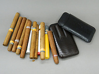 BNPS.co.uk (01202 558833)<br /> Pic: BNPS<br /> <br /> PICTURED: A selection of John McCririck cigars will be up for auction<br /> <br /> The widow of the late racing pundit John McCririck is selling off his wardrobe of clothes and jewellery.<br /> <br /> The TV personality was known for wearing deerstalker hats, flamboyant suits and oversized gold rings as he delivered the betting news at the races on Channel 4 for years.<br /> <br /> He did July aged 79 and now his widow Jenny has decided to put some of his possessions up for sale.<br /> <br /> She said part of the reason was that she was worried thieves would target her because of the jewellery that her husband was famous for wearing.