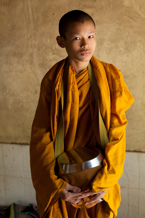 Portrait of a young monk near Battambang, Cambodia. <br /> <br /> Photos &copy; Dennis Drenner 2013.