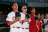Peoria Chiefs pitcher Derian Gonzalez (16), designated hitter R.J. Dennard (35) and teammates line up during the national anthem before a game against the Dayton Dragons on May 6, 2016 at Dozer Park in Peoria, Illinois.  Peoria defeated Dayton 5-0.  (Mike Janes/Four Seam Images)