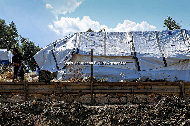 Pictured: A woman stands outside her tent.<br /> Re: Everyday life at the Moria refugee camp on the island of Lesbos, Greece.