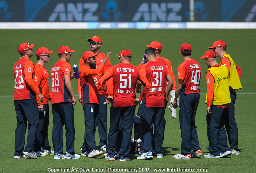 The England team celebrate the dismissal of New Zealand's Colin de Grandhomme. Twenty20 International cricket match between NZ Black Caps and England at Westpac Stadium in Wellington, New Zealand on Sunday, 3 November 2019. Photo: Dave Lintott / lintottphoto.co.nz