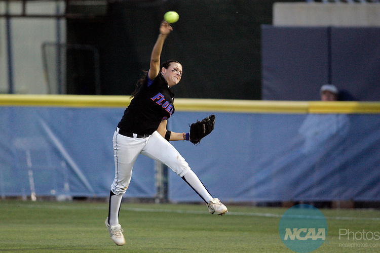 02 JUNE 2009:  Kelsey Bruder (2) of the University of Florida quickly returns the ball to the infield against the University of Washington during the Division I Women's Softball Championship held at the ASA Hall of Fame Stadium in Oklahoma City, OK.  Washington defeated Florida 3-2 in game two to win the national championship.  Shane Bevel/NCAA Photos