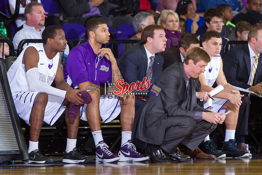 High Point Panthers head coach Scott Cherry looks at his notes during first half action against the Wofford Terriers at Millis Athletic Center on November 24, 2013 in High Point, North Carolina.  The Panthers defeated the Terriers 66-56.   (Brian Westerholt/Sports On Film)