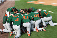 "Miami Hurricanes team prayer during a game vs. the University of South Florida Bulls in the ""Florida Four"" at George M. Steinbrenner Field in Tampa, Florida;  March 1, 2011.  USF defeated Miami 4-2.  Photo By Mike Janes/Four Seam Images"