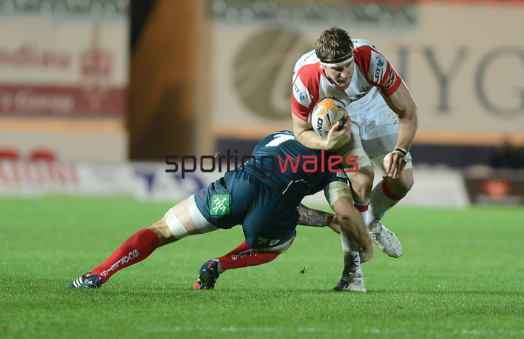 Ulster's Robbie Diack is tackled by Scarlet's Josh Turnbull <br /> <br /> Rugby - Scarlets V Ulster - Rabo Direct Pro 12- Saturday 02nd November 2013 - Parc y Scarlets  - Llanelli <br /> <br /> © www.sportingwales.com- PLEASE CREDIT IAN COOK