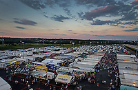 Sep 13, 2013; Charlotte, NC, USA; Overall view of the NHRA professional pit area as the sun sets during qualifying for the Carolina Nationals at zMax Dragway. Mandatory Credit: Mark J. Rebilas-