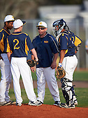 Boca Ciega Pirates assistant coach Richie Watkins talks with pitcher Andrew Pedroff (2) as Lazero Rodriguez (left) and catcher Ivan Rodriguez (12) listen in during a game against the Lakeland Spartans at Boca Ciega High School on March 2, 2016 in St. Petersburg, Florida.  (Copyright Mike Janes Photography)