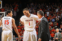 Virginia guard Justin Anderson (1) talks with Virginia head coach Tony Bennett during the game against Wake Forest Wednesday Jan. 08, 2014 in Charlottesville, Va. Virginia defeated Wake Forest 74-51.