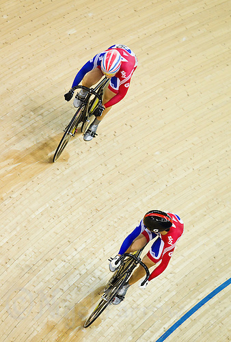 18 FEB 2012 - LONDON, GBR - Great Britain's Victoria Pendleton (GBR) (bottom with black helmet) watches her Team Sprint team mate Jess Varnish (GBR) during their quarter final battle for a Women's Sprint semi final place at the UCI Track Cycling World Cup, and London Prepares test event, for the 2012 Olympic Games in the Olympic Park Velodrome in Stratford, London, Great Britain .(PHOTO (C) 2012 NIGEL FARROW)