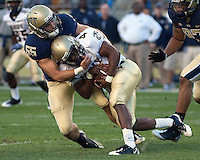 Pittsburgh linebacker Max Gruder (55) sacks Navy quarterback Ricky Dobbs.  The Pittsburgh Panthers defeated the Navy Midshipmen 27-14 at Heinz Field, Pittsburgh, PA.