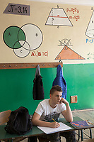 "Serbia. Knjazevac is a town and municipality located in the Zaječar District of the eastern Serbia. « Vuk Karadzic » Primary School. Classroom. 8th Grade. Student during mathematics class. Formulas, mathematical relationships  and geometric figures. The number π is a mathematical constant. Originally defined as the ratio of a circle's circumference to its diameter, it now has various equivalent definitions and appears in many formulas in all areas of mathematics and physics. It is approximately equal to 3.14159. The Pestalozzi Children's Foundation (Stiftung Kinderdorf Pestalozzi) is advocating access to high quality education for underprivileged children. It supports in Knjazevac a project called "" Education for child rights"" 20.4.2018 © 2018 Didier Ruef for the Pestalozzi Children's Foundation"