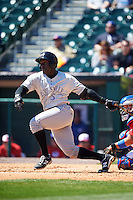 Louisville Bats second baseman Jermaine Curtis (5) at bat during a game against the Buffalo Bisons on May 2, 2015 at Coca-Cola Field in Buffalo, New York.  Louisville defeated Buffalo 5-2.  (Mike Janes/Four Seam Images)