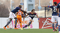 New England Revolution defender Kevin Alston (30) celebrates his goal with teammates.  In a Major League Soccer (MLS) match, the New England Revolution (blue/white) defeated Houston Dynamo (orange), 2-0, at Gillette Stadium on April 12, 2014.