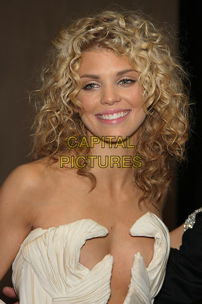 ANNALYNN McCORD .Celebrity Sighting at the 67th Annual Golden Globes inside the Beverly Hilton hotel, Beverly Hills, CA, USA,.January 17th, 2010..globes portrait headshot hairband hair band head headband white cream smiling curly  strapless cleavage plunging neckline .CAP/LNC/ALB.©LNC/Capital Pictures