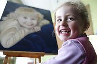 16/11/07 SW. Alicia Kelly, 3, gives her approval to the over-lifesize portrait, painted by Dennis Hall, that her mother won through a Citylife giveaway..Photo: Crispin Anderlini