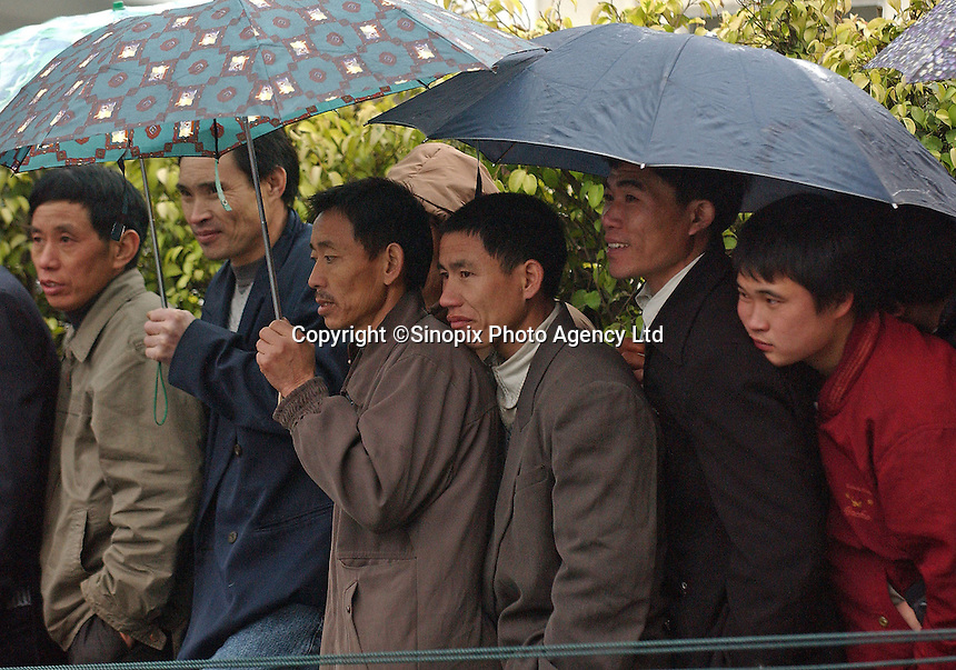 Migrant workers at Guangzhou Railway station prepare to leave Guangdong Province for the Lunar New Year. Guangdong Province has the largest migrant labor force in south China with milions streaming through the station to the conjested railways..01-FEB-05