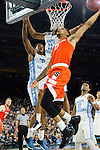 02 APR 2016: Forward Michael Gbinije (0) of Syracuse University hooks in a shot in front of Forward Kennedy Meeks (3) and Forward Brice Johnson (11) of the University of North Carolina during the 2016 NCAA Men's Division I Basketball Final Four Semifinal game held at NRG Stadium in Houston, TX. North Carolina defeated Syracuse 83-66 to advance to the championship game.  Brett Wilhelm/NCAA Photos