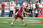 Washington State punter, Oscar Draguicevich, punts during the Cougs big Alamo Bowl victory over the Iowa State Cyclones, giving WSU a season record 11th victory.