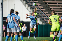 Seattle, WA - Sunday, April 17, 2016: Seattle Reign FC forward Beverly Yanez (17) and Sky Blue FC defender Erica Skroski (8) go up for a header. Sky Blue FC defeated the Seattle Reign FC 2-1 during a National Women's Soccer League (NWSL) match at Memorial Stadium.