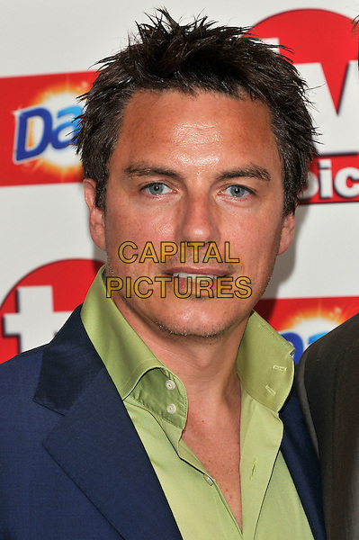 JOHN BARROWMAN .Attending the TV Choice Awards 2010 at The Dorchester, London, England, UK, September 6th, 2010..arrivals portrait headshot green shirt blue .CAP/PL.©Phil Loftus/Capital Pictures.