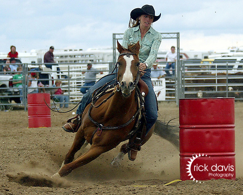 Candace Mallette rounds the barrels with the fast time of 17.40 seconds to win the ladies barrel race at the Southeast Weld County CPRA Rodeo in Keenesburg, Colorado on August 12, 2006.