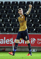 Per Mertesacker of Arsenal greets away supporters after the Barclays Premier League match between Swansea City and Arsenal at the Liberty Stadium, Swansea on October 31st 2015