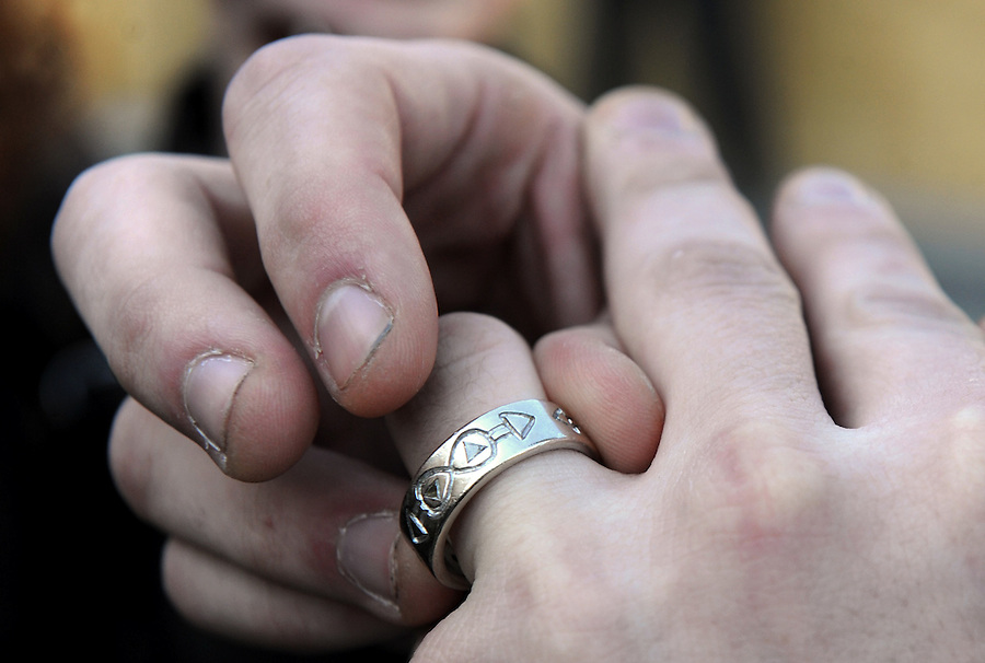 Robert Hawthorne, 24, of Washington, DC, plays with his ring as he talks to friends outside of the Superior Court of D.C. after marrying his partner James Betz, 23 on Tuesday, March 9, 2009. Hawthorne and Betz had the rings customized with two male symbols converging. It was the first day that same-sex couples could marry in the District of Columbia.