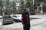 December 16, 2010. Raleigh, NC.. TP Mishra talks to a neighbor in his apartment complex. There are immigrants from many countries in the complex, including Mexico, Somalia and Vietnam, most of whom are attracted by the cheap rent.. TP Mishra, a refugee from Bhutan, has recently relocated from the Bronx to Raleigh, where he lives in an suburban apartment  with his wife, as well as another Bhutanese couple.