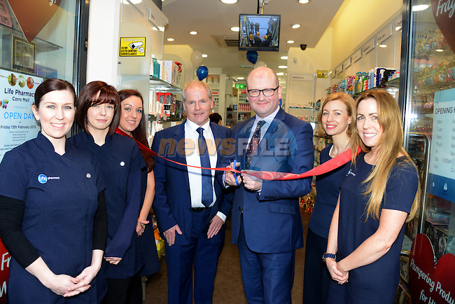 Minister Ged Nash cuts the tape to officially open the new Life Pharmacy at Mell watched by Managing Director John Carr (centre) and staff (from left) Anne Martin, Sarah Cunningham, Anita Geraghty, pharmacist Mary Boissieux and Elaine Corcoran. Picture: Newsfile