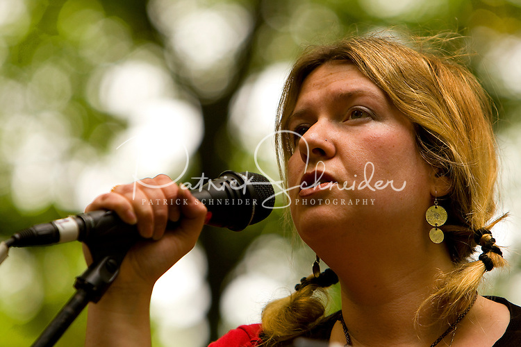 A woman sings during the 52nd Annual Grandfather Mountain Highland Games in Linville, NC.