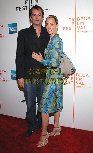 "MANUEL BOYER & KIM RAVER.Attends the premiere of the new film, ""Slingshot"",  at the Tribeca Film Festival in downtown Manhattan, New York, USA, 26th April 2005..full length turquoise blue green snakeskin print belted shirt dress bag husband wife married.Ref: ADM.www.capitalpictures.com.sales@capitalpictures.com.©Patti Ouderkirk/AdMedia/Capital Picture."