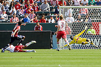 New York Red Bulls goalkeeper Bouna Coundoul (18) can't reach a ball shot by Chivas USA midfielder Jesus Padilla (10). Chivas USA defeated the Red Bulls of New York 2-0 at Home Depot Center stadium in Carson, California April 10, 2010.  .