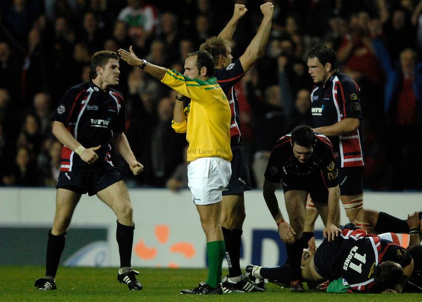 Photo: Richard Lane..London Irish v Llanelli Scarlets. Heineken Cup. 20/10/2006. .Scarlets' players celebrate victory as referee, Romain Poite blows the final whistle.