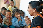 Children sing a song in a class in Pida, a village in Nepal's Dhading District where the United Methodist Committee on Relief (UMCOR), a member of the ACT Alliance, is helping families to rebuild their lives in the wake of the 2015 earthquake that ravaged much of Nepal.