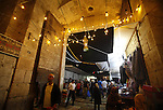 Palestinians walk in an illuminated street before attending the Taraweeh prayer at the al-Aqsa mosque compound in the old city of Jerusalem after breaking the fast on the First day of the Moslem holy month of Ramadan on July 10, 2013. Photo by Saeed Qaq