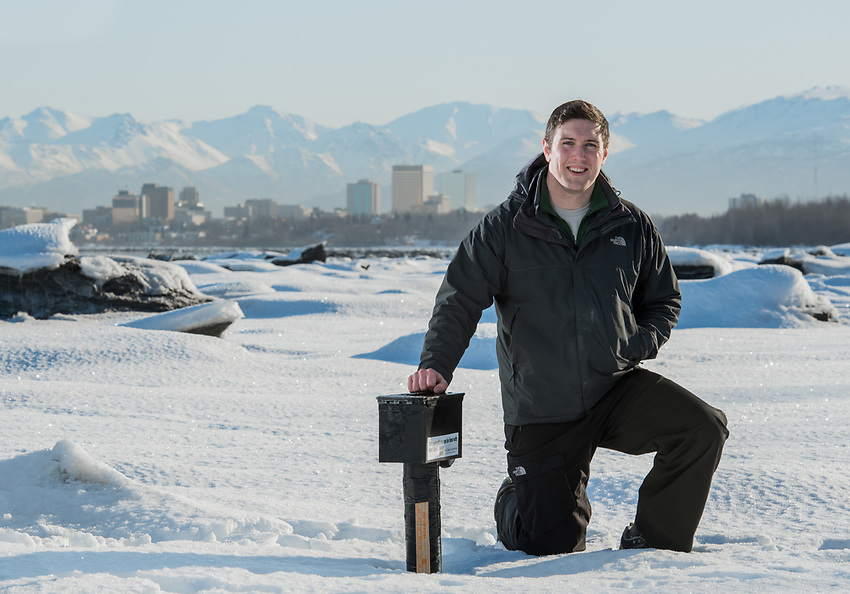UAA Civil Engineering grad student Euan-Angus Macleod at his study site in Earthquake Park. Macleod maintains a sensor package that monitors ground temperature on the shore of Cook Inlet as part of his coastal erosion research.
