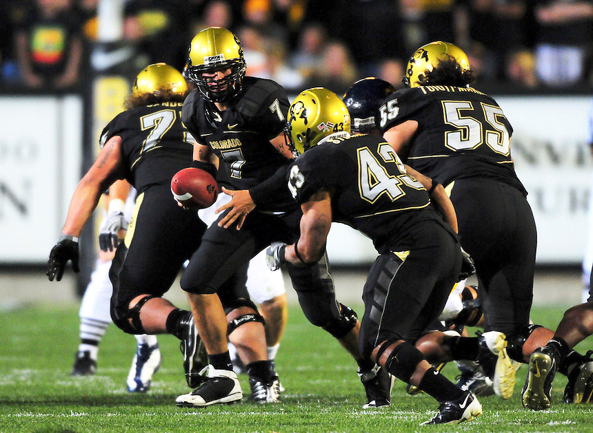 18 September 08: Colorado quarterback Cody Hawkins (7) prepares to hand off to tailback Rodney Stewart (43) during a game against West Virginia. The Colorado Buffaloes defeated the West Virginia Mountaineers 17-14 in overtime at Folsom Field in Boulder, Colorado. For Editorial Use Only.