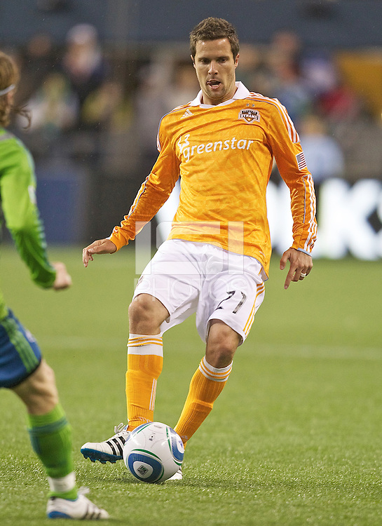 Houston Dynamo defender Hunter Freeman passes the ball during play against Seattle Sounders FC at Qwest Field in Seattle Friday March 25, 2011. The match ended in a 1-1 draw.