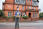 &copy; Joel Goodman - 07973 332324 . 24 August 2013 . Manchester , UK . Alain with the freshly picked kiwifruit harvest, in front of the library where he grew the vine.<br /> <br /> The stunning summer has brought an astonishing crop of exotic kiwifruit for one gardener - beside a busy main road in Manchester.<br /> <br /> Green-fingered Alain Kahan grew the exotic &quot;Actinidia deliciosa&quot; - or &quot;Fuzzy Kiwifruit&quot; - vine from scratch after buying a punnet of the fruit from a Manchester Asda in 1989 and cultivating the plant in the small garden of the library where he worked.<br /> <br /> &quot;I blended the pulp with water and allowed the seeds to separate before planting them out&quot; says Alain.<br /> <br /> Alain has since retired but, despite having only a small patch of land in which to grow and no greenhouse for protection, the vine has thrived and this year's long, hot summer has delivered a stunning haul of supermarket-sized kiwis, more typically found growing in the warmer climbs of Italy and New Zealand.<br /> <br /> The fruit grows well in areas where there are no frosts to damage the flesh. According to Alain, the long, warm spell was just what was needed. &quot;Last year's early frost turned the fruit to mush but the long summer meant I could wait that bit longer - this year's been perfect for them&quot;.<br /> <br /> Retired Librarian Alain was so surprised at the size of the crop, that he's kept the vine's location a closely-guarded secret. Fortunately fears that the furry fruit would be stolen from the roadside before they ripened have proved unfounded and Alain's now harvesting bowlfuls of the fruit, which he says he'll share with colleagues and friends at the library in Salford, where he still helps out two days a week.<br /> <br /> &quot;They have a better taste than the ones from the Supermarket&quot; insists the sixty-five year old amateur gardener, &quot;it must be something in the Salford soil&quot;.<br /> <br /> The home of the kiwifruit can be traced to southern China, only arriving in New Zealand at the turn of the twentieth century, where the frost-free climate proved well-suited