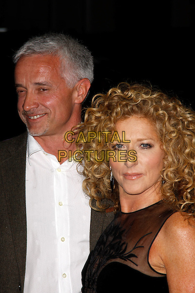 John Gardner & Kelly Hoppen.Rodial Beautiful Awards, Sanderson Hotel, London, England..March 6th, 2012.half length grey gray suit jacket white shirt black sheer couple .CAP/AH.©Adam Houghton/Capital Pictures.